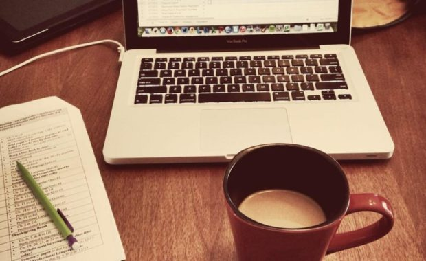 computer and coffee for work from home cyber security jobs